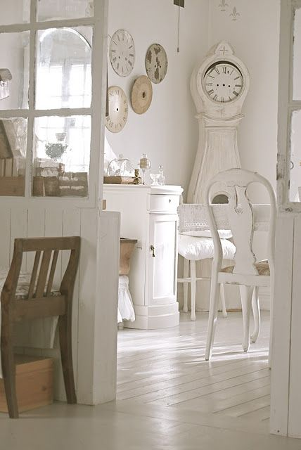 White Swedish style dining room with white Mora clock - found on Hello Lovely Studio