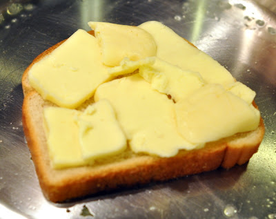 sliced cheese on bread