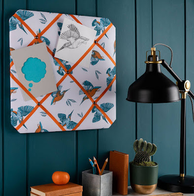 ribbon board: white fabric with blue kingfishers; orange ribbon