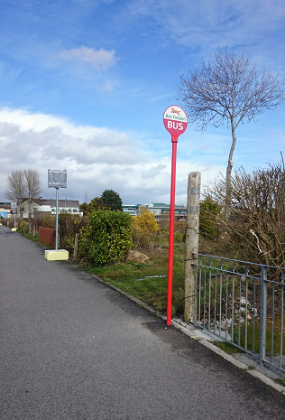 2015 install Bus Éireann bus stop pole, tarmacadem installation into the footpath