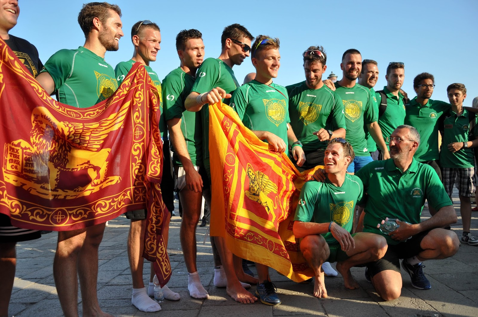 The winning team with the flag of Venice, Regatta of the Ancient Maritime Republics, Venice, Italy