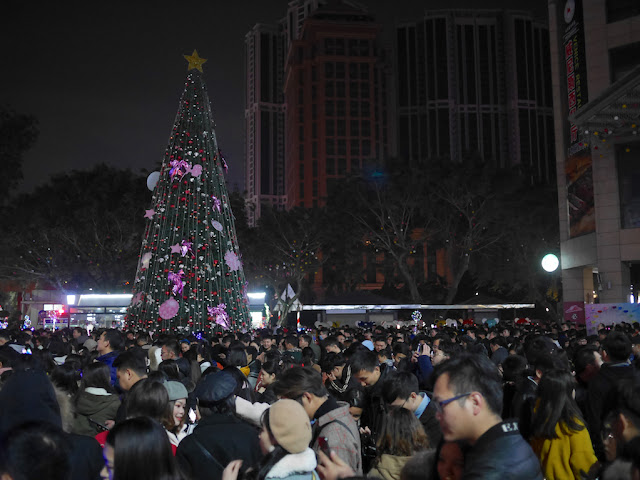 people gathering to celebrate the first moments of 2019 at Central Power Plaza in Zhongshan, China