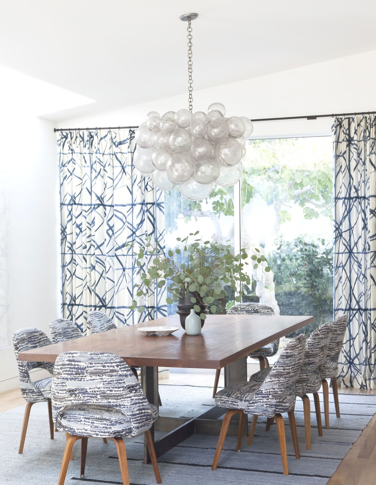 Dining room with a bubble chandelier