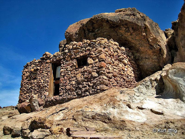 There are several wood and rock shelters built in the the cliffs above Calico.