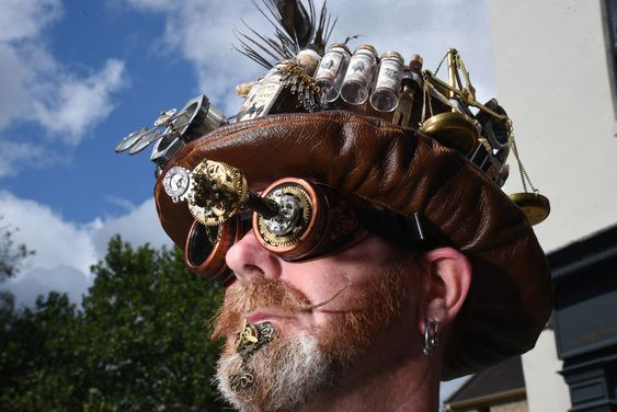 man with steampunk makeup - metal gears, propeller, octopus trinkets, embellishments glued to his face