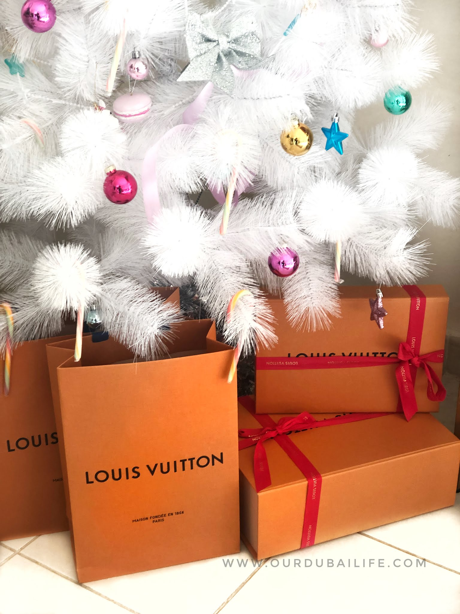 Louis Vuitton Xmas bags under the Christmas Tree