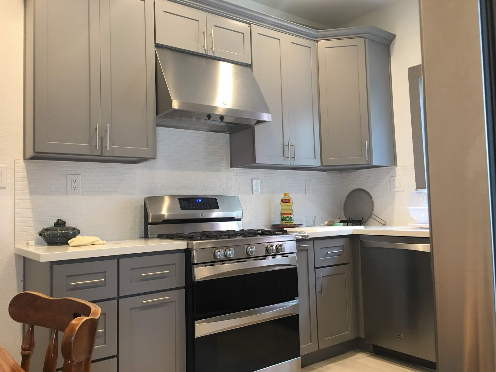 Small Kitchen Remodel With Grey Cabinets And Quartz Countertop