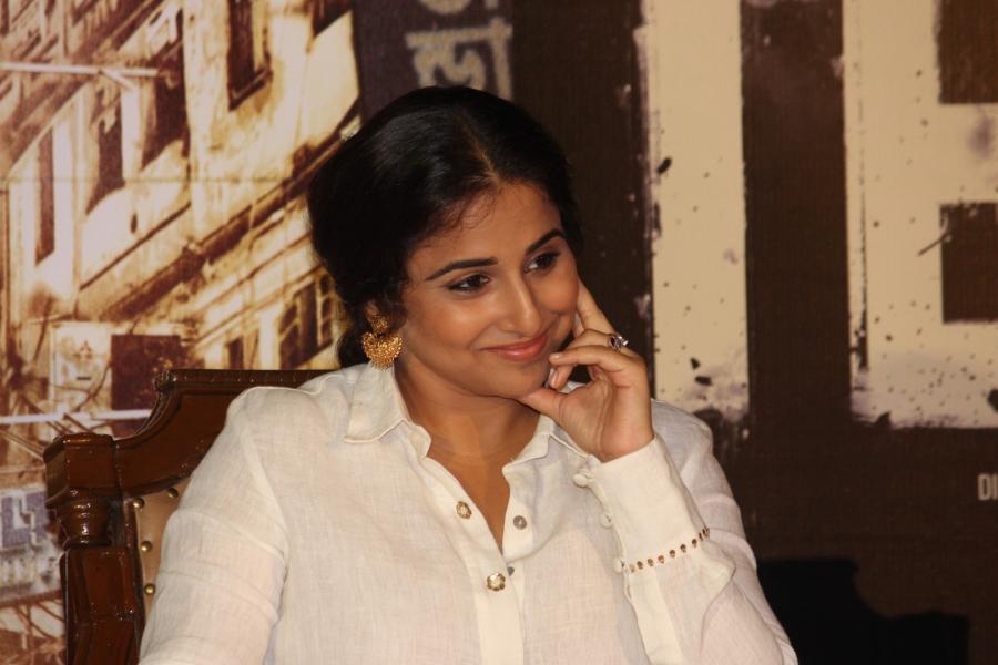 Vidya Balan Smiling Face Photos In White Dress