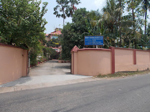 "Entrance to  ""Holy Cross Institute"" which houses ""Holy Cross Seniour Citizens home""."