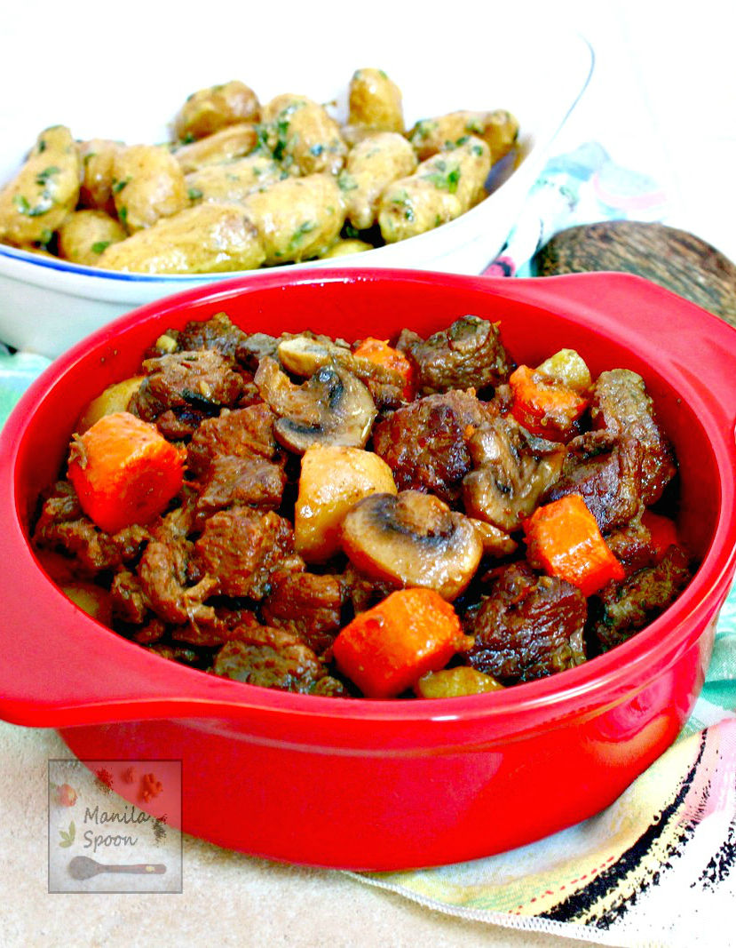 Beef chunks are simmered in red wine in the slow cooker and results in a melt-in-your-mouth delicious stew! Make this crockpot version of the classic French stew - Beef Burgundy (Boeuf Bourguignon) in the morning and enjoy it for dinner! | manilaspoon.com