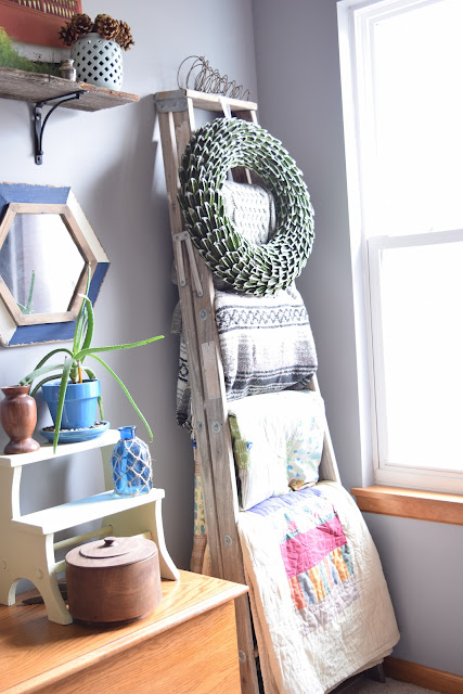 Blanket ladder with a wreath styled for winter