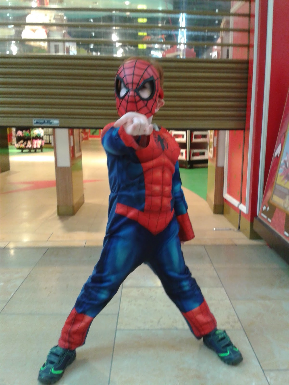 Ieuan dressed as spiderman outside Hamleys Toystore Cardiff