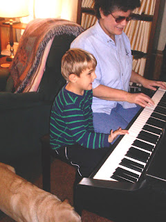Laurel and Dalton at the piano