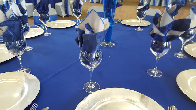royal blue and silver wedding by eventsojudith, blue napkins in glasses
