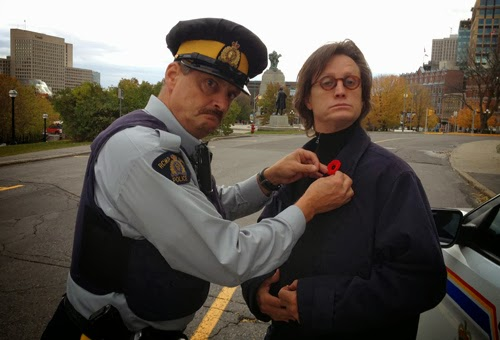 officer pinning medal on a man's chest