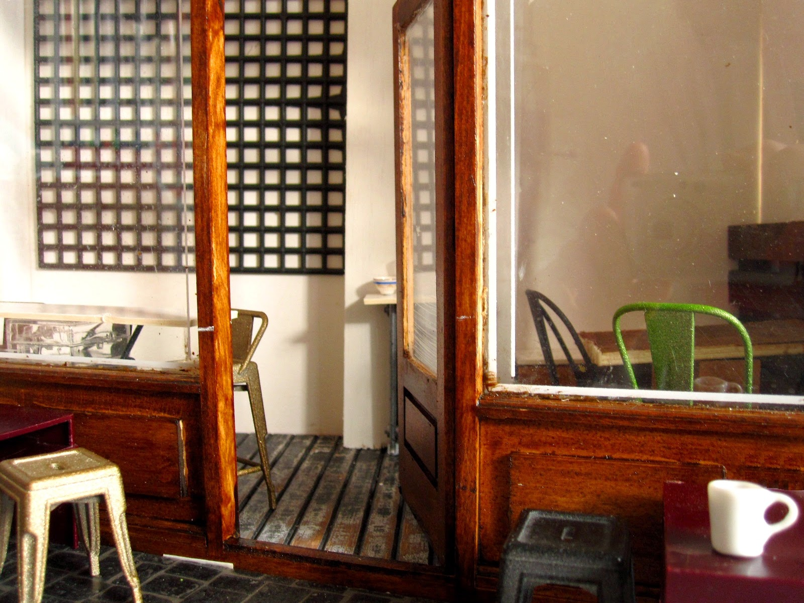 Modern dolls' house half-built miniature cafe scene.