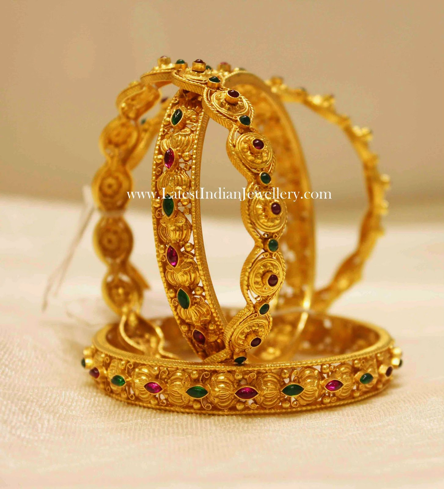 Gold Bangles with Ruby Emeralds