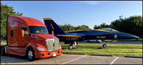 Kenworth T680 with a U.S. Navy Blue Angels Boeing F-18 Hornet