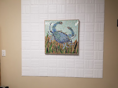 crab mosaic on textured wall