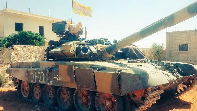Τ-90 με σιιτική σημαία στο Χαλέπι.