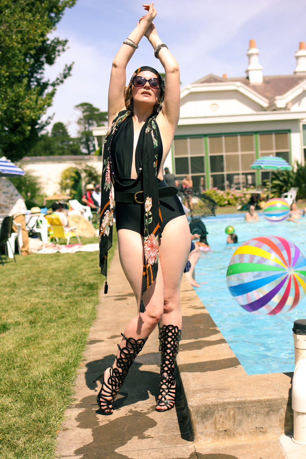 @findingfemme wears flapper swimwear to the art deco pool party at Mooramong Homestead.