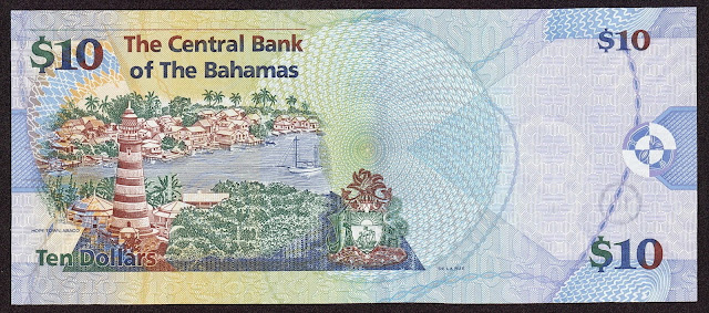 Bahamas money currency 10 Dollars banknote 2009 red and white candy cane striped lighthouse in Hope Town