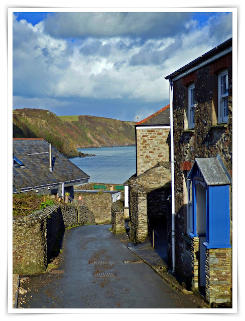 Road and cottages in Gorran Haven, Cornwall