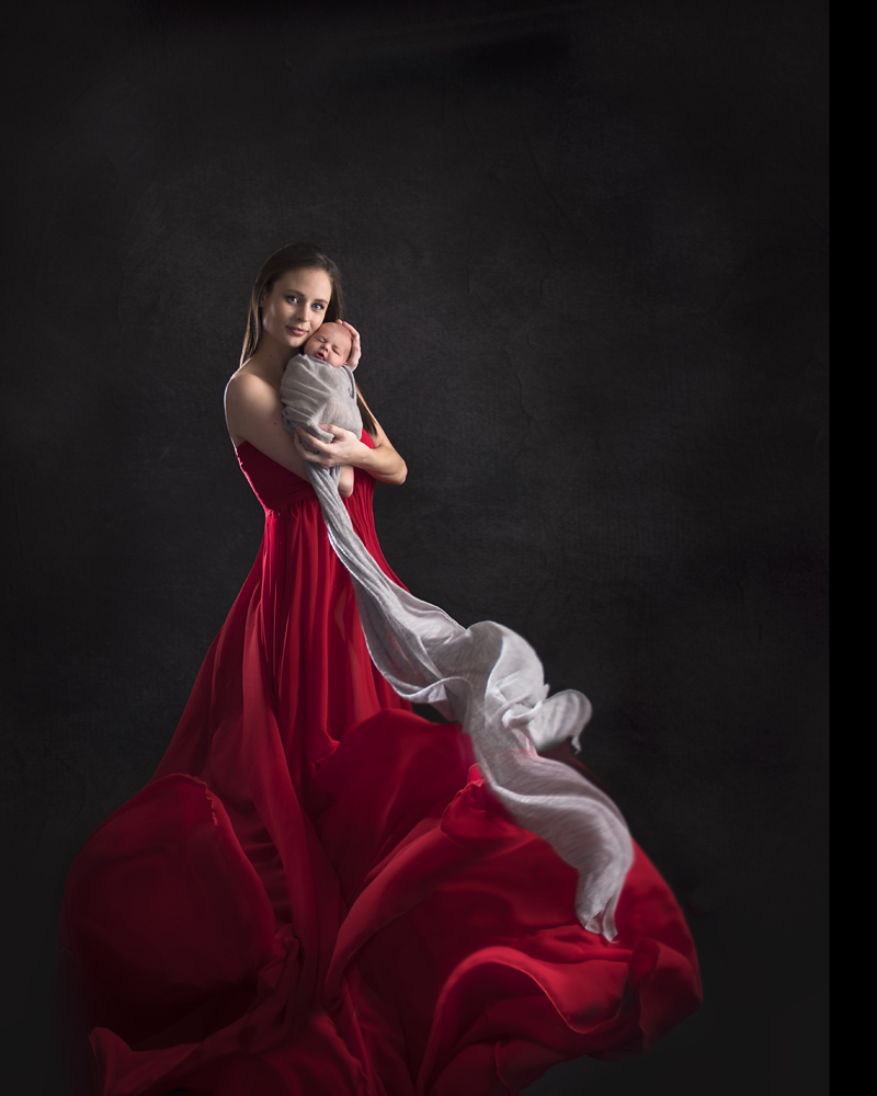 beautiful mother and newborn in flowing dress dekalb newborn photographer