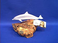 dolphin figurine on burled wood by john perry