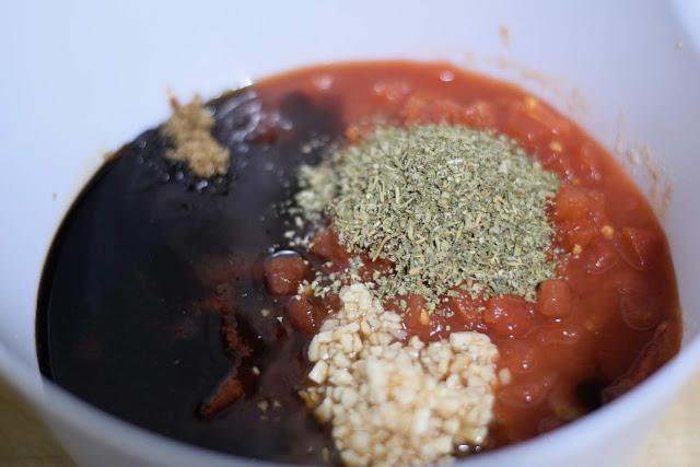 marinara sauce, balsamic vinegar, garlic, diced tomatoes, Italian seasoning, brown sugar, salt, and pepper in a mixing bowl.