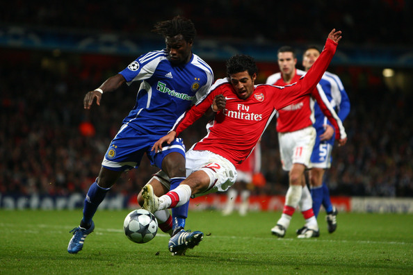 Carlos Vela of Arsenal battles for the ball with Pape Diakhate of Dynamo Kiev during the UEFA Champions League Group G match between Arsenal and Dynamo Kiev at the Emirates Stadium on November 25, 2008 in London, England
