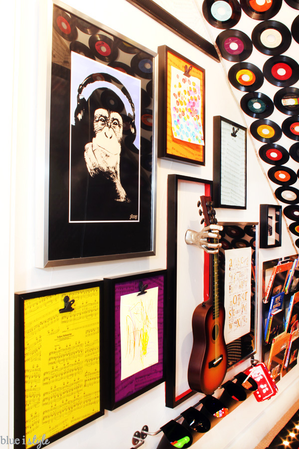 Rock & Roll under stairs playroom with a music gallery wall.