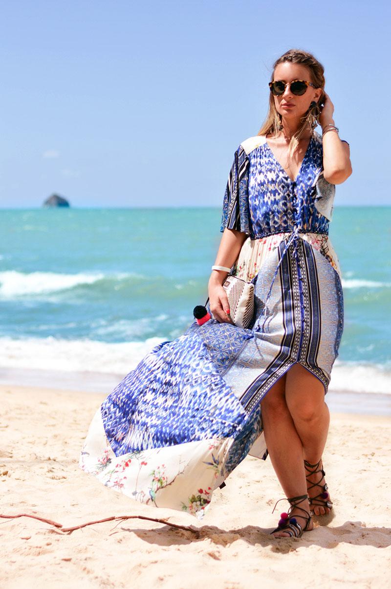 how to wear a boho maxi dress for a beach holiday blue boho printed maxi dress on beach