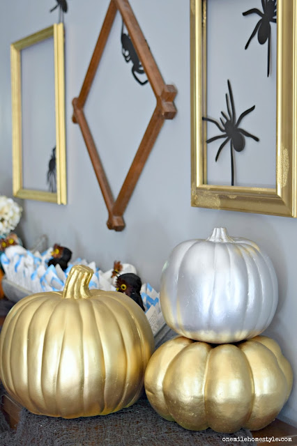 Add a little Halloween glam to you home by spray painting plain faux pumpkins with gold and silver metallic spray paint!