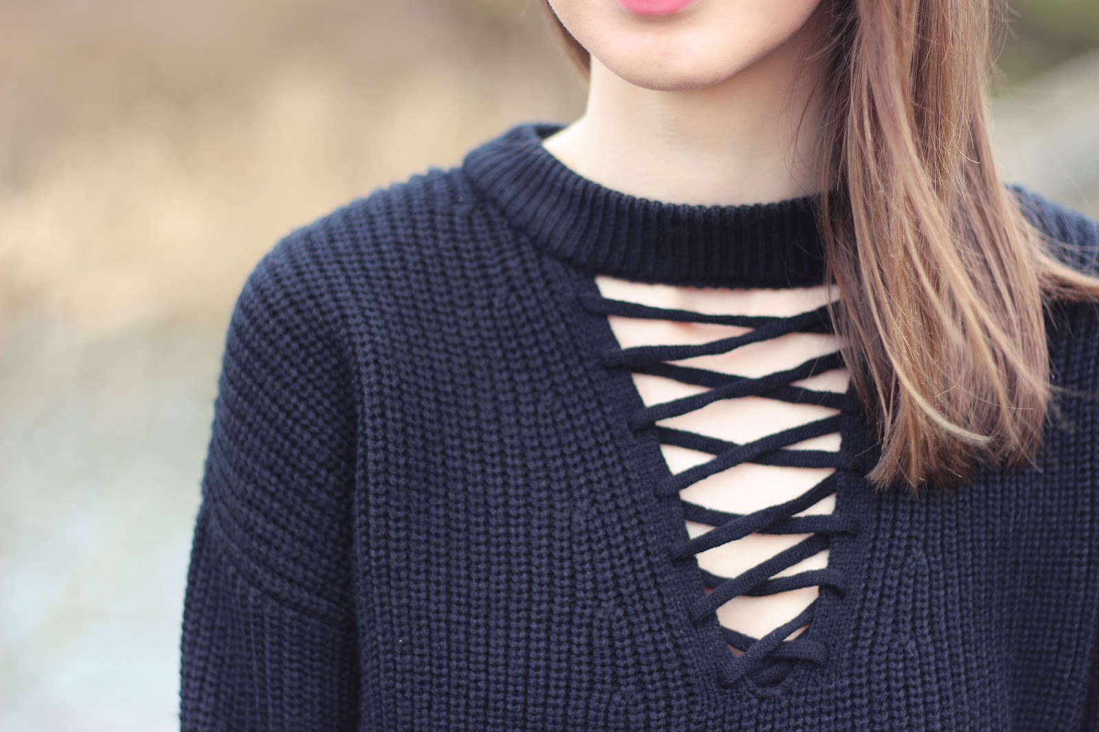 Image of a lace up jumper from New Look