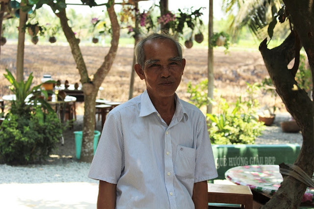 Coconut farmer along the Mekong Delta with Les Rives, Vietnam - lifestyle and travel blog