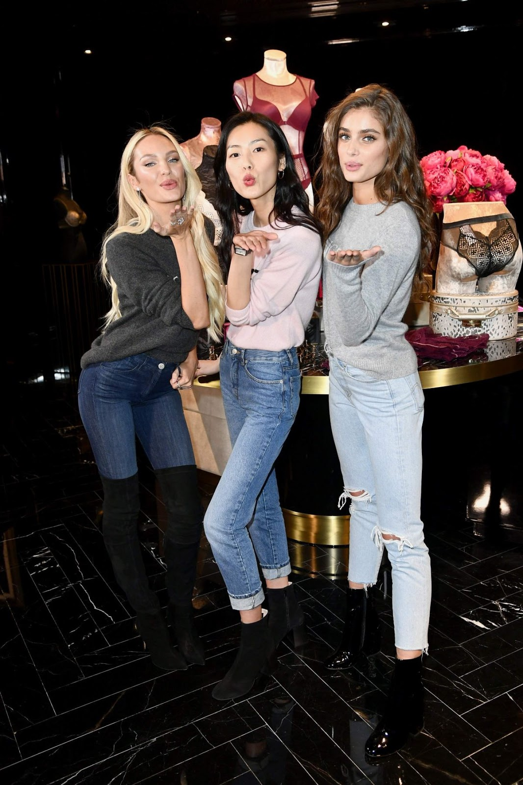 Candice Swanepoel, Liu Wen and Taylor Hill a Victoria's Secret Store in Sanghai
