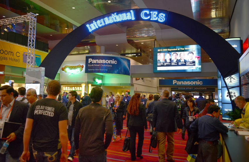 people walking through CES arch
