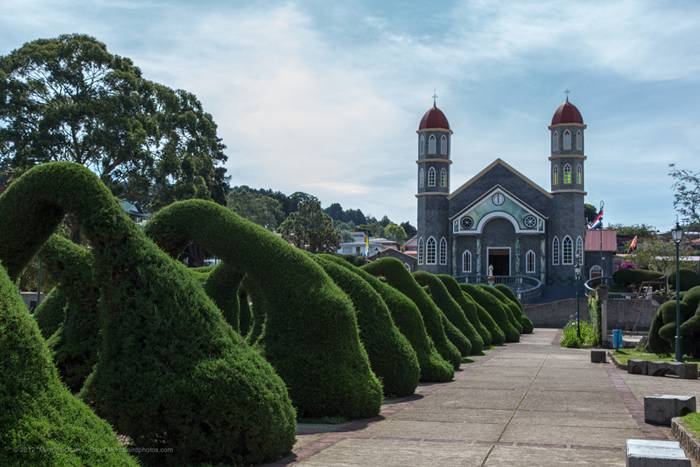 The park sits in front of the church at the town center. It is noted for its topiary garden produced and maintained by Evangelisto Blanco since the 1960s. Shrubs in the park have been trimmed into the shapes of various animals, including some that are quite abstract and bizarre.