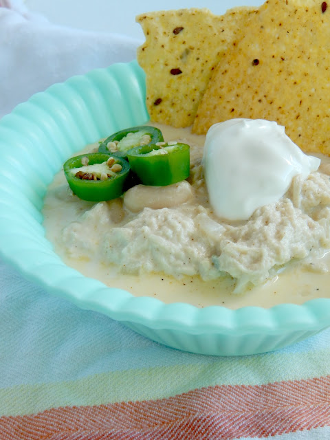 Creamy White Chicken Chili...a simple, one pot 30 minute soup that you're family will love!  Creamy, cheesy and comforting for the winter months. (sweetandsavoryfood.com)