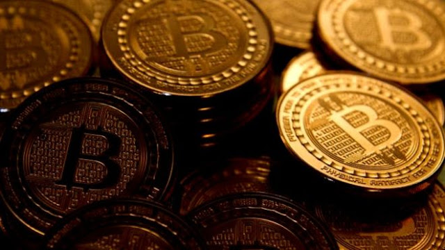 Bitcoin currency hits new record high