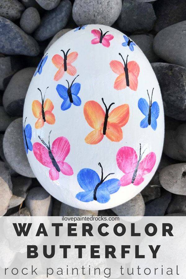 Watercolor butterfly rock painting ideas. I love this for garden art. This same technique would look great on stepping stones, too. #rockpainting #PaintedRockIdeas #paintedrocks #paintrock #paintedstone #rockart #stoneart #paintedstoneideas #ilovepaintedrocks #crafts #rockcrafts #butterfly #butterflycraft