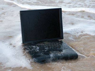 Laptop Terendam Air