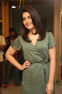 Actress Raashi Khanna Stills in Green Short Dress at Mirchi 95 Suno Aur Mercedes Jeeto Contest  0043.JPG