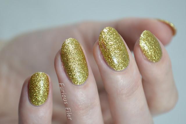 nails inc chelsea embankment swatch yellow glitter