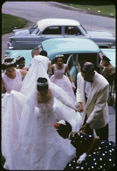 Carmen de Lavallade 1955 arriving at church in beautiful white wedding dress with attendant in polka dot dress assisting