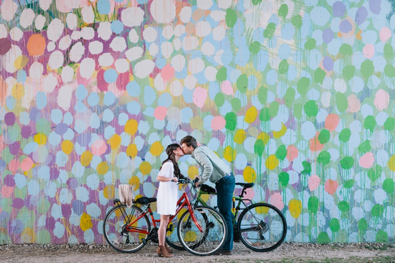 taylor and seth biking on the atlanta beltline for their engagement session