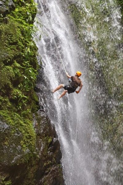 Rapelling down a waterfall in Costa Rica