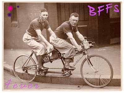 Two men riding a tandem bike. Are they teacher and student? BFFs?