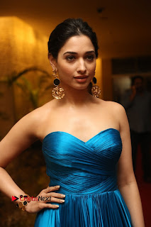 Tamannah Bhatia Beautiful eager Smile in Blue Deep neck Long Dress at Abvhinetri Audio Launch
